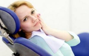 Почему болит зуб под пломбой: симптомы, причины